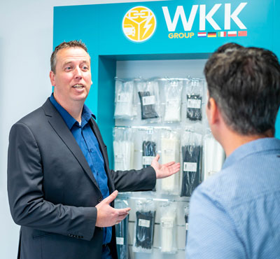 WKK employee talks to customer about cable ties