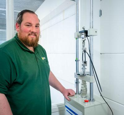 WKK employee tests tensile strength of cable tie