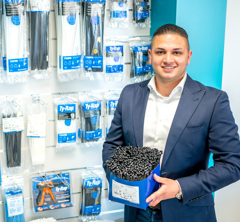 WKK employee with cable ties of the brand Ty-Rap®