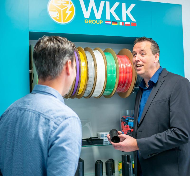 WKK employee talking with customer about Hongshang heat shrink tubing