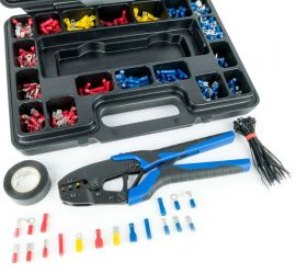An opened assortment box containing crimp terminals, 261 pieces, with a black-blue colored crimping tool for crimp terminals in front of the assortment box.
