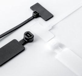 Two natural colored and two black marker cable ties, in multiple versions, on a white background.