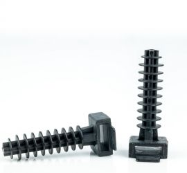 Two black wallplugs for cable ties, one pictured lying down and one pictured standing upright, on a white background.
