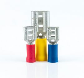 A red, a yellow and a blue insulated spade connector, without sleeve, standing upright on a white background.